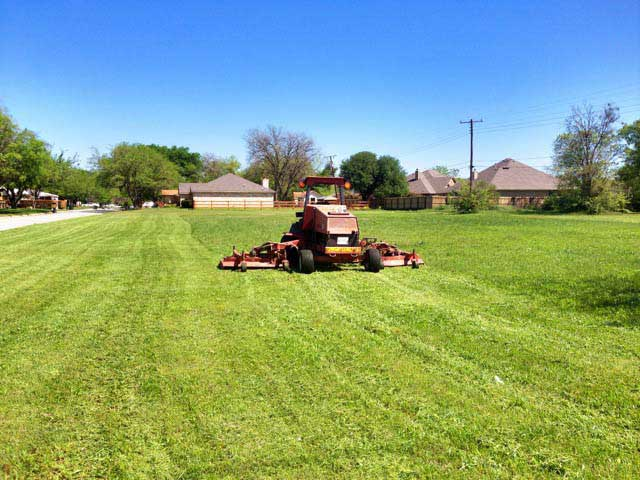Fort Worth tractor mowing